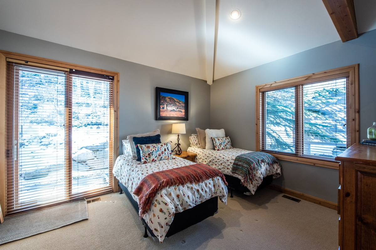 Bedroom 3. Twin beds and door to patio and hot tub.