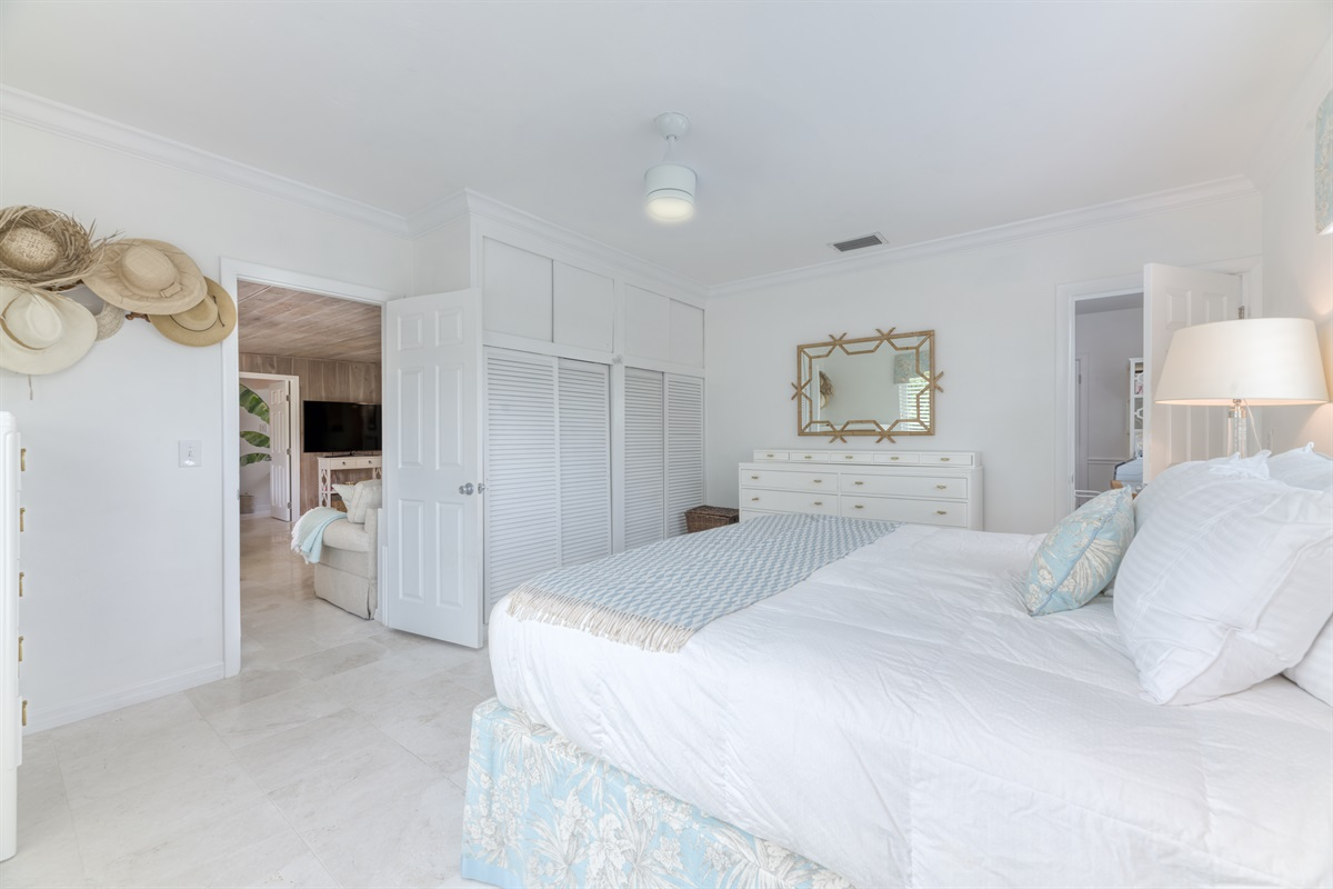 Master Bedroom with California King Bed and views of the pool & pool deck. Plenty of closet & dresser space