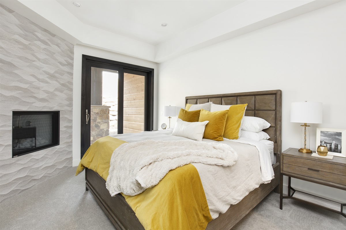 Master Bedroom: Cozy gas fire, doors to patio.