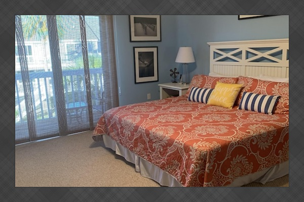 Master bedroom with  balcony. Two chairs on balcony for your relaxation!
