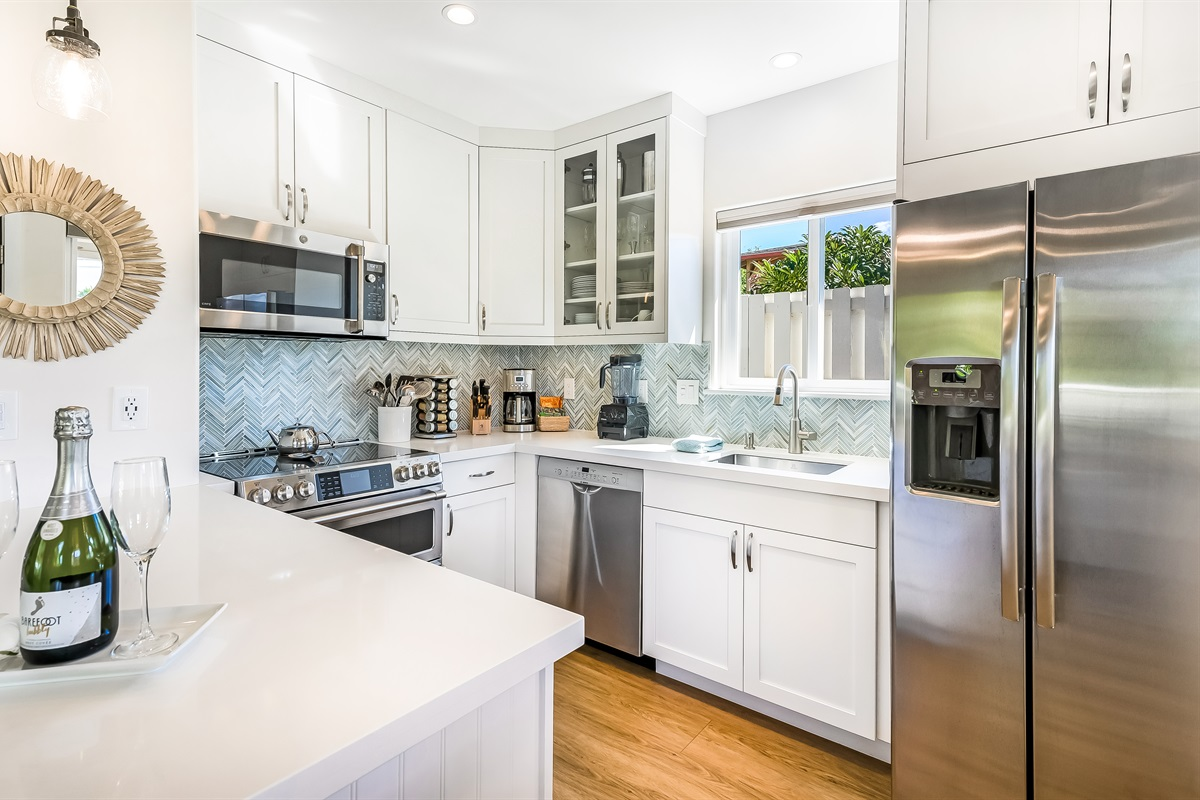 Gourmet kitchen with induction range, Vitamix, German knives, and more