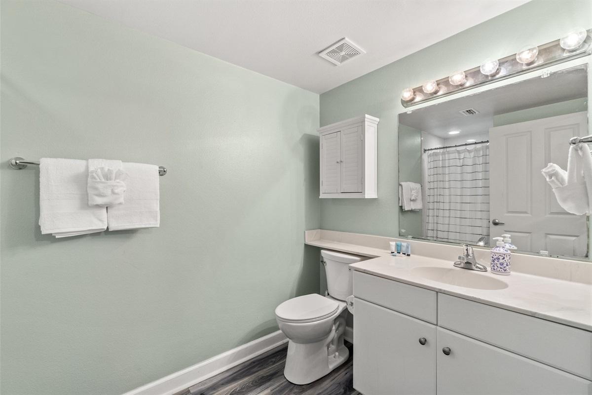 Bunk bathroom with walk-in shower