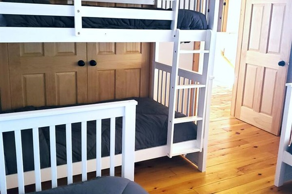 Bunk bed room with 4 twins. This room is loft style overlooking the living room