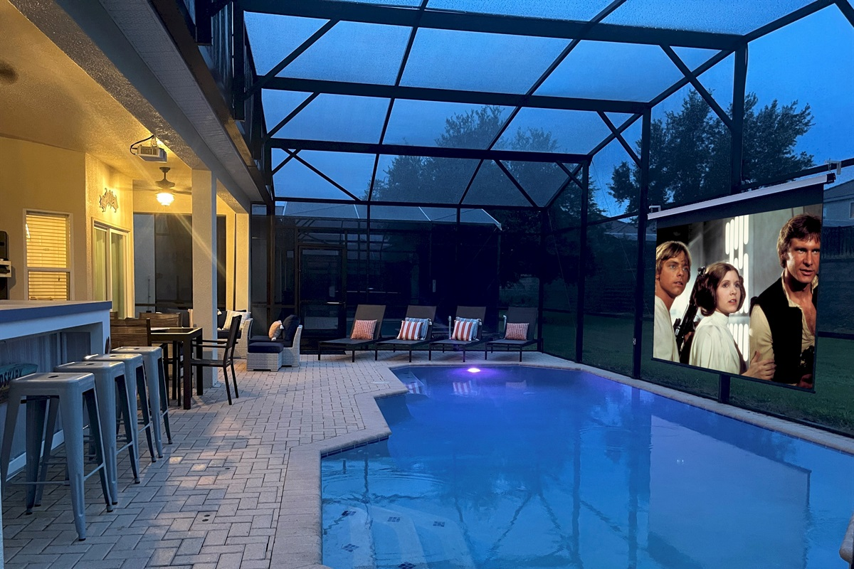 """Poolside Movie Theater With 125"""" Screen, 4K Projector And Premium Sound System"""