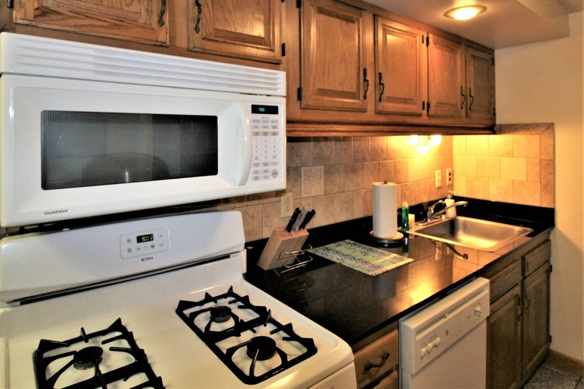 Gas range, full size microwave oven and dishwasher
