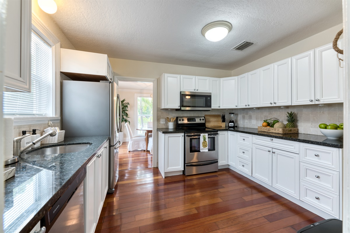 Black Granite tops, newly renovated kitchen, stainless steel double fridge, oven, stove, Keurig & all utensils needed to feed your hungry family & friends.