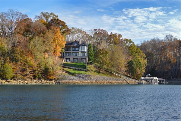 Enjoy amazing lake views, wooded privacy and your own luxury boat dock