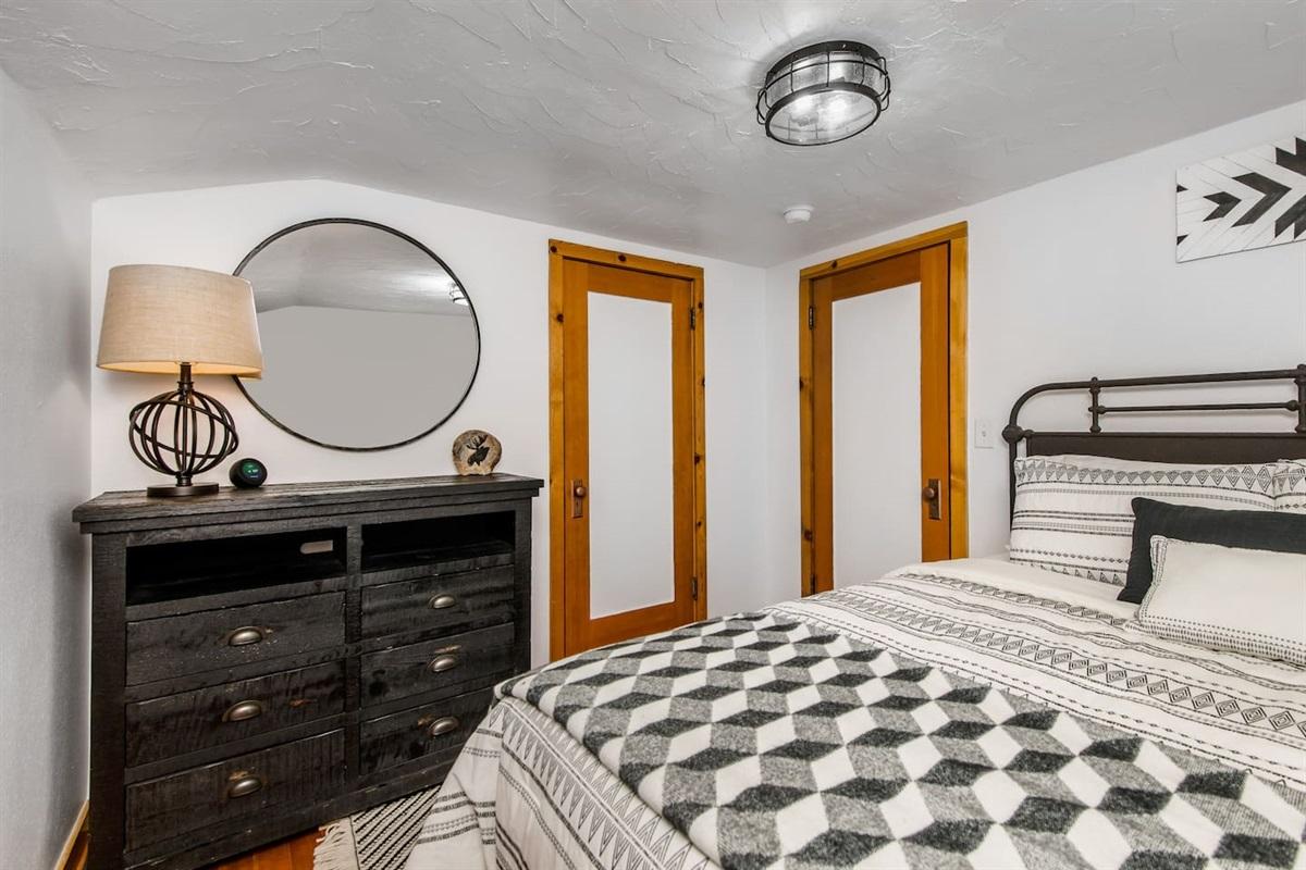 Bedroom #2 (Upper Level): Bedroom features TV, dresser, and 1 queen bed.