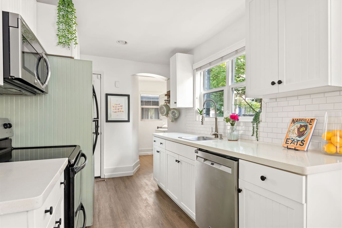 The  bright and airy kitchen has been renovated with stainless steel appliances and dishwasher