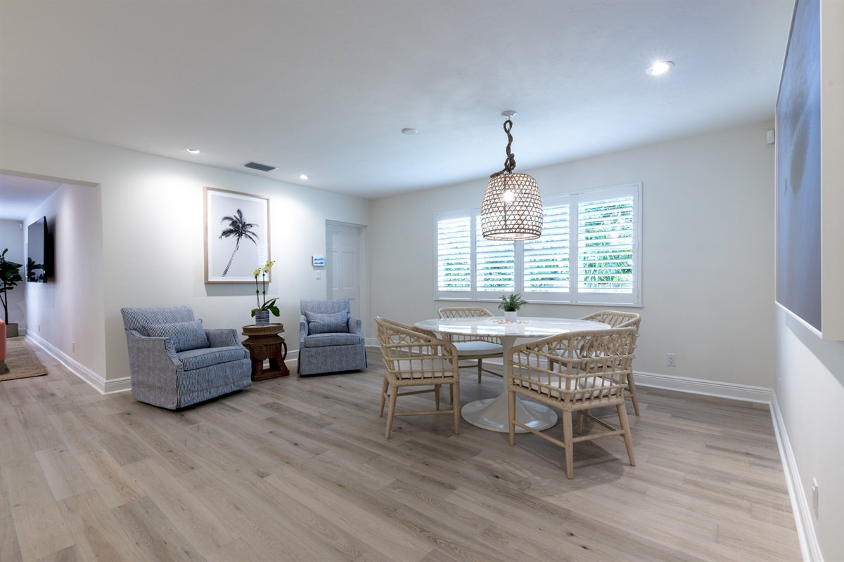 Dine in luxury under the low hanging rustic light & woven chairs, gorgeous marble dining room table with views on the open plan kitchen.