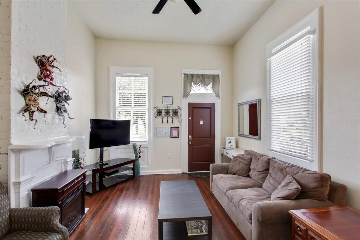 """front door, living room, 47"""" cable HDTV, queen sleeper sofa, electric fireplace"""