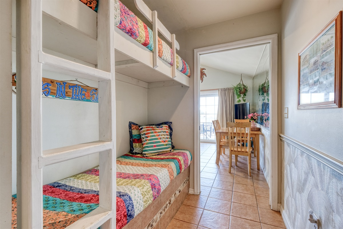 Twin bunk beds on hall