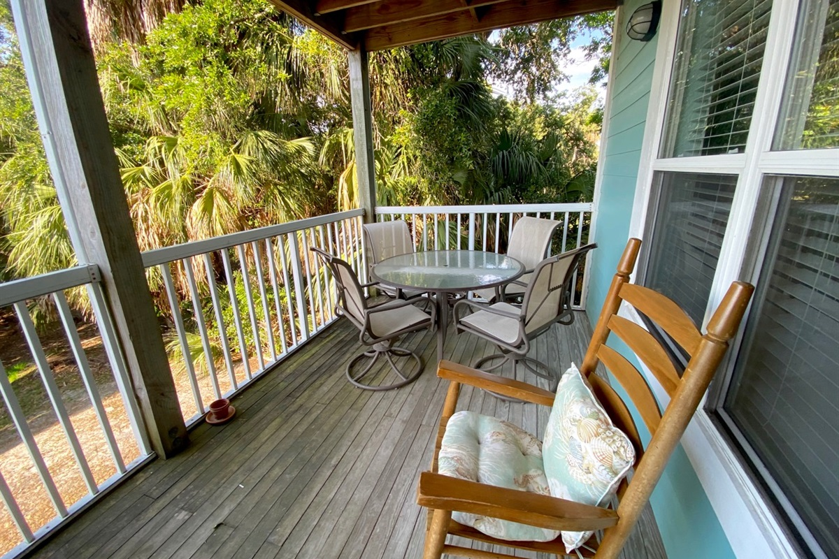 Breezy porch on corner unit has no neighbors