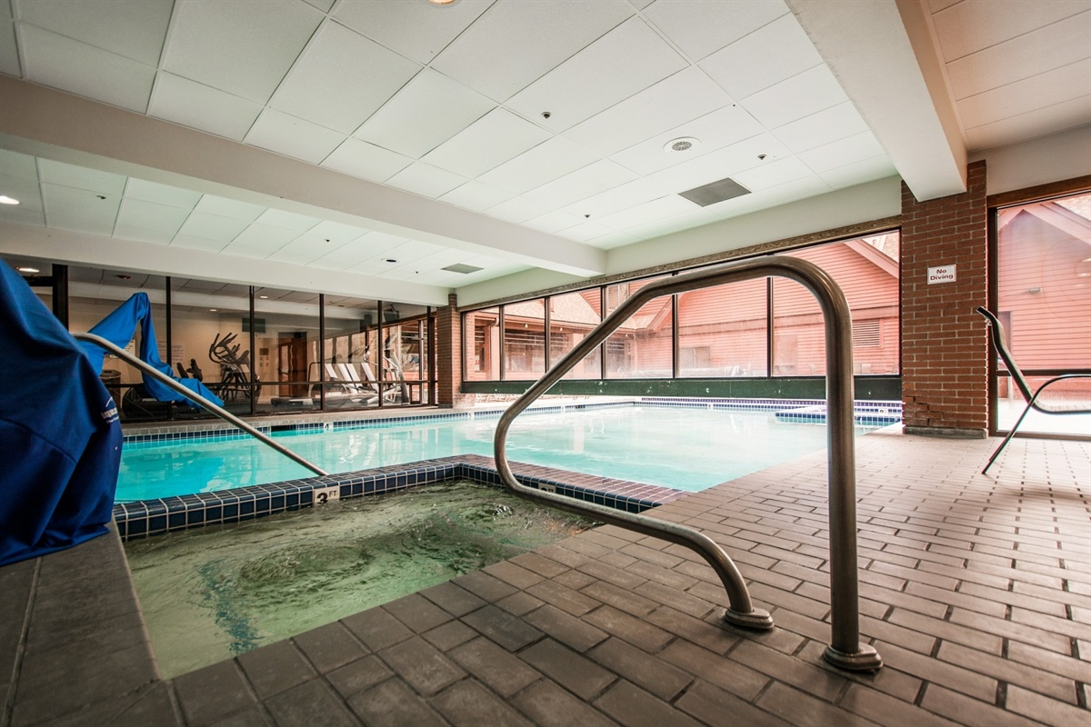 Cute indoor / outdoor pool located just down in the elevator