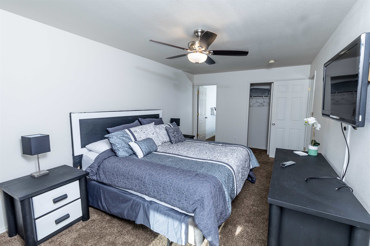 The king-size bed in the expansive master suite offers comfort and space!
