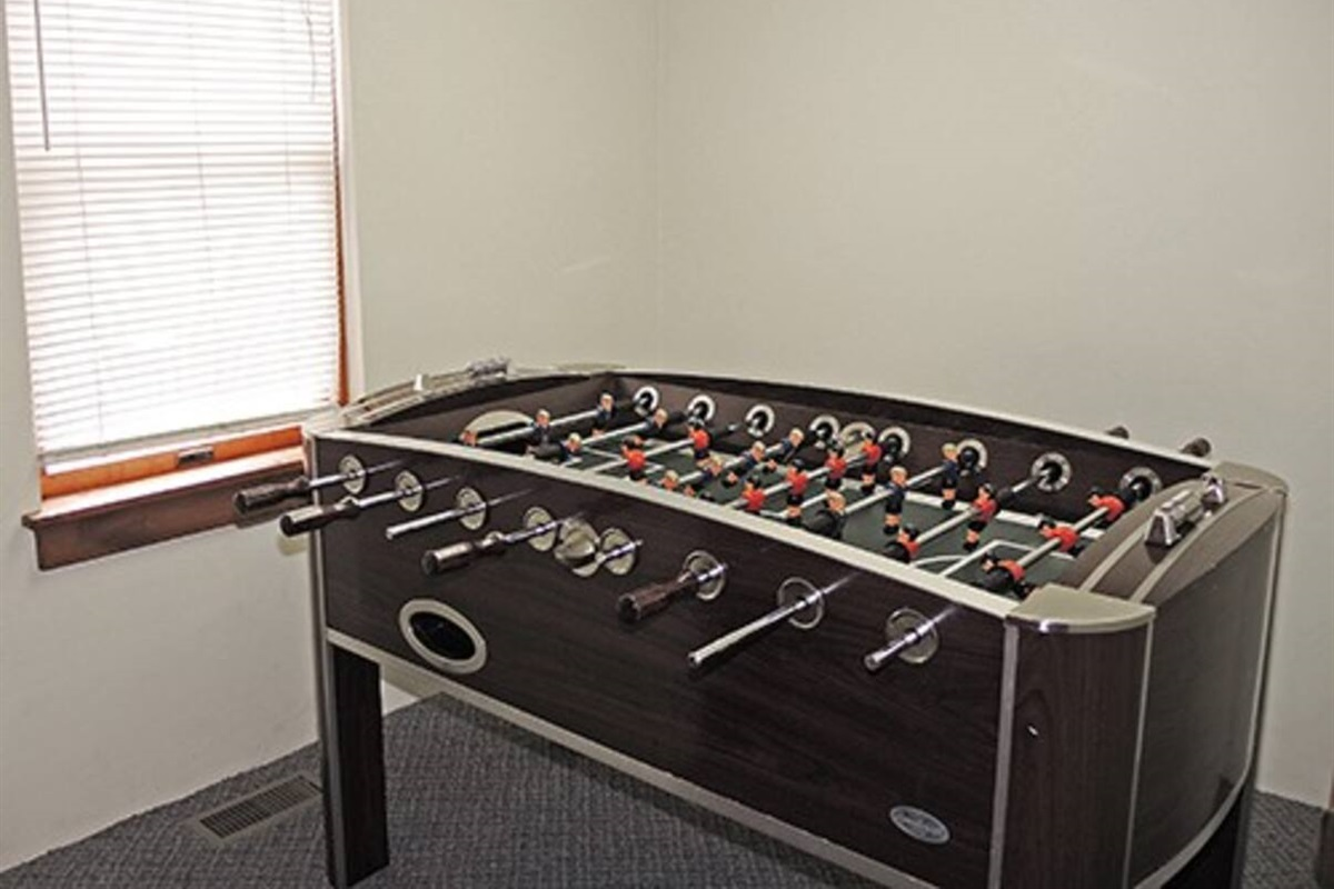 A game room with foosball table