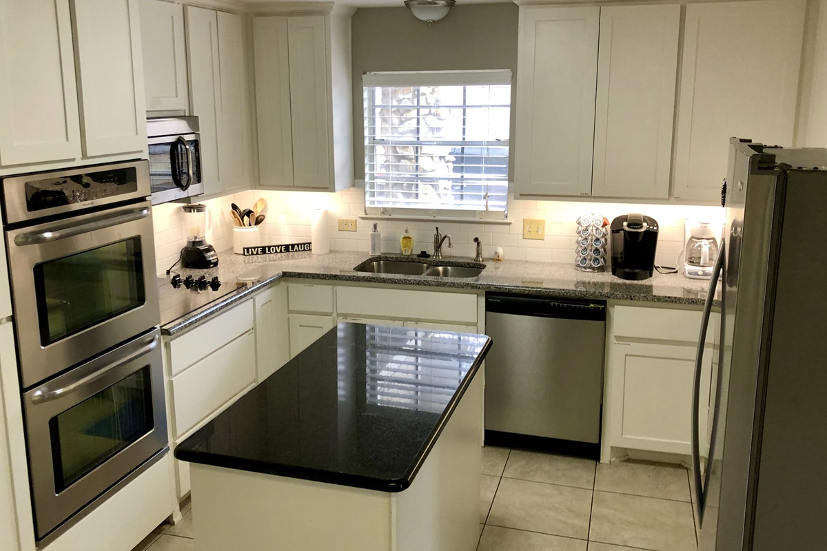 Your fully equipped kitchen with brand new appliances and granite countertops.