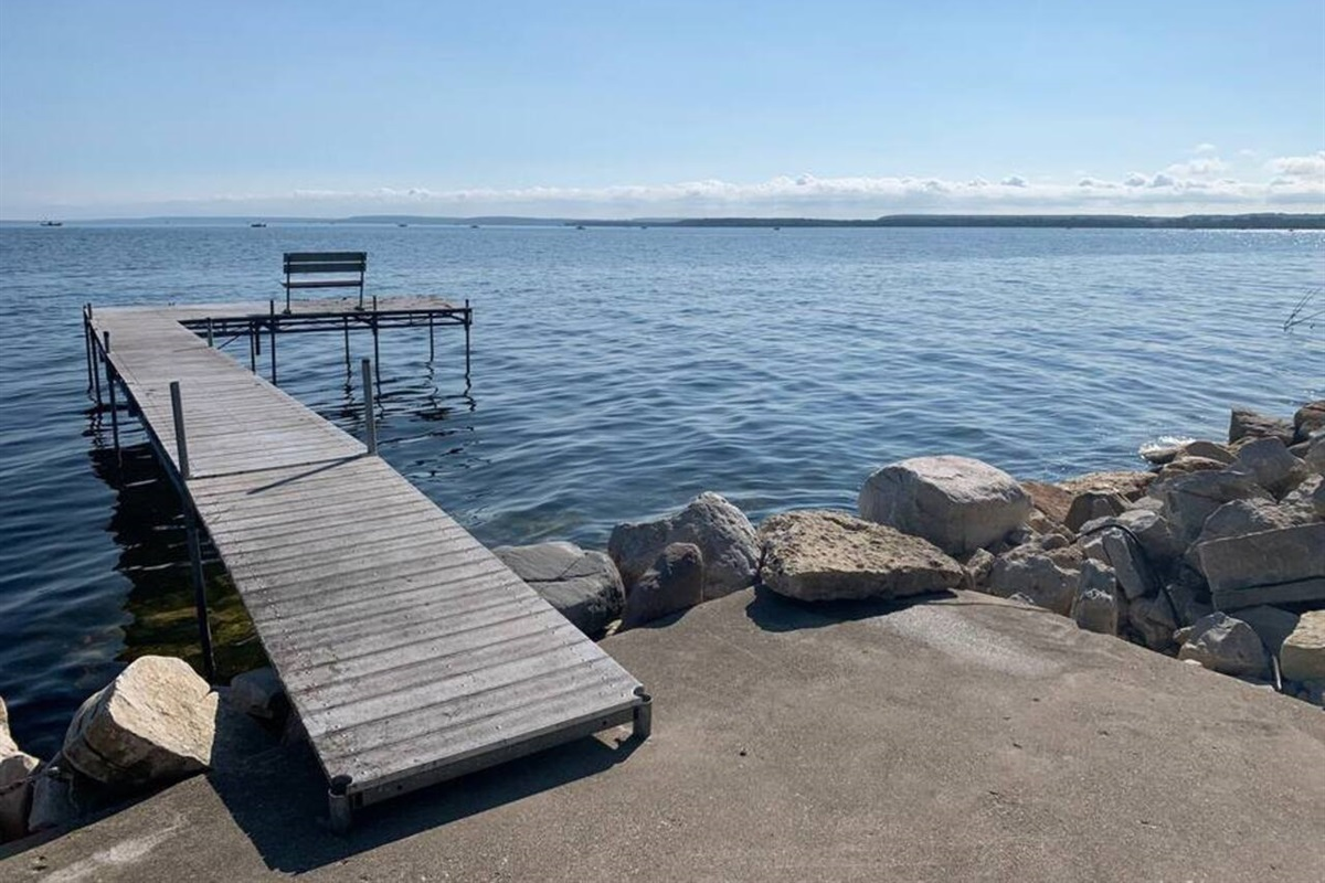 Our dock extends WAY OUT into the bay and is great for swimming and fishing off of.