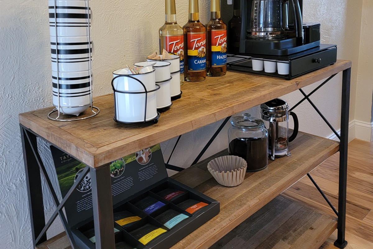 Great coffee bar with K-cups, drip coffee, french press, and flavored syrups!