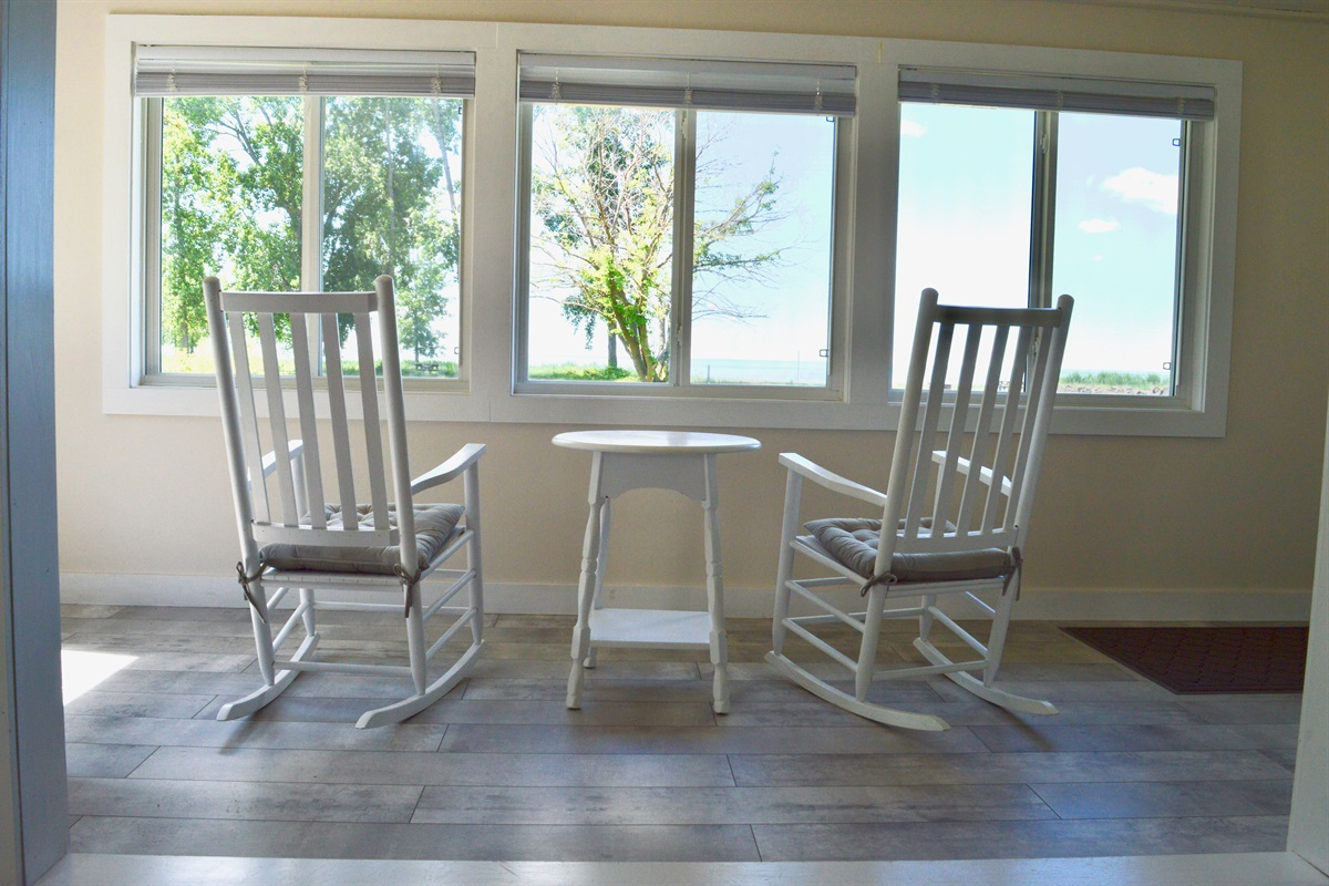 Luxurious lounging chairs set up with a perfect view onto the property, a wonderful area to enjoy a beverage.
