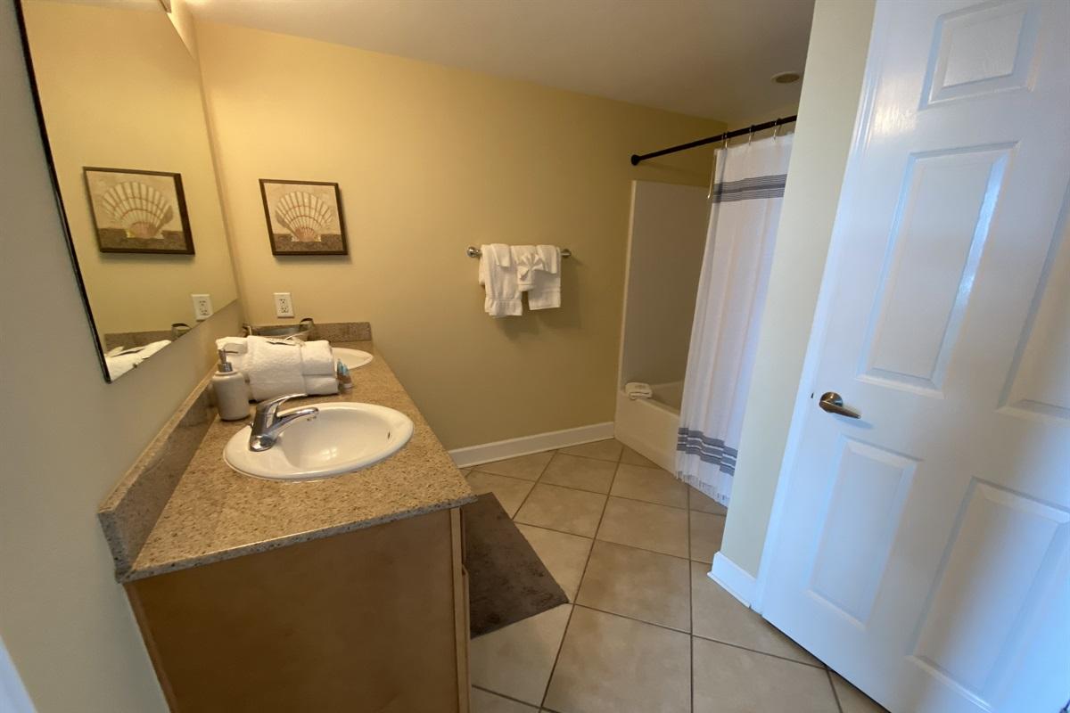 Master bath, tub shower combo and double vanities