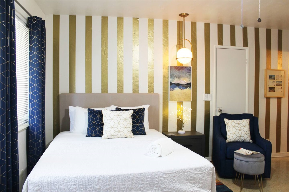 Stylish art deco themed bedroom area with bedside reading lamp on a dimmable switch.