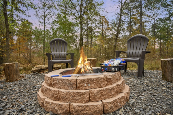 Private fire pit behind cabin