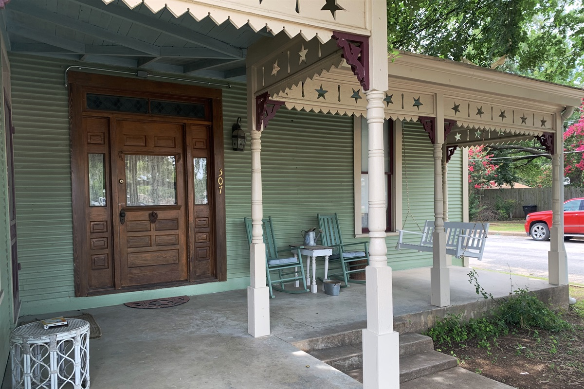 Relax on the cozy porch swing or rocking chair