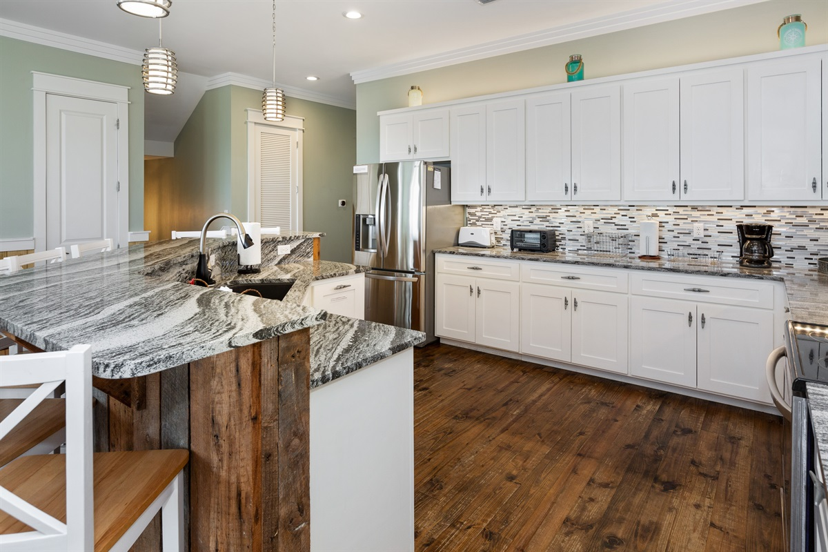 One of two user-friendly kitchens in this home. No tripping over each other in here! Everyone gets to help cook and clean up with a kitchen this size!