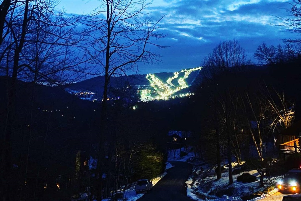 Photo taken by guest February 2021 of the ski slopes lit up at night from our balcony.
