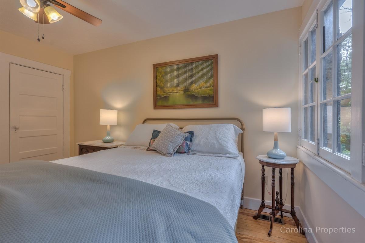 Upper level bedroom 2 with queen size bed.