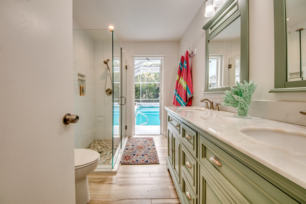 Pool bath opens to hall for guest room as well