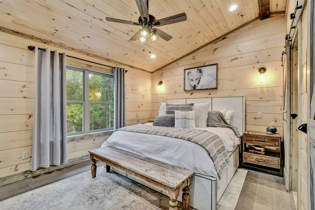 The Fox Hole King Master Suite is on the upper level with a great view of the Smoky Mountains
