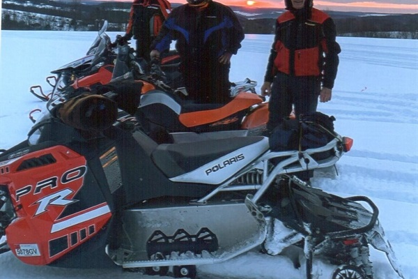 Snowmobile as sunset.
