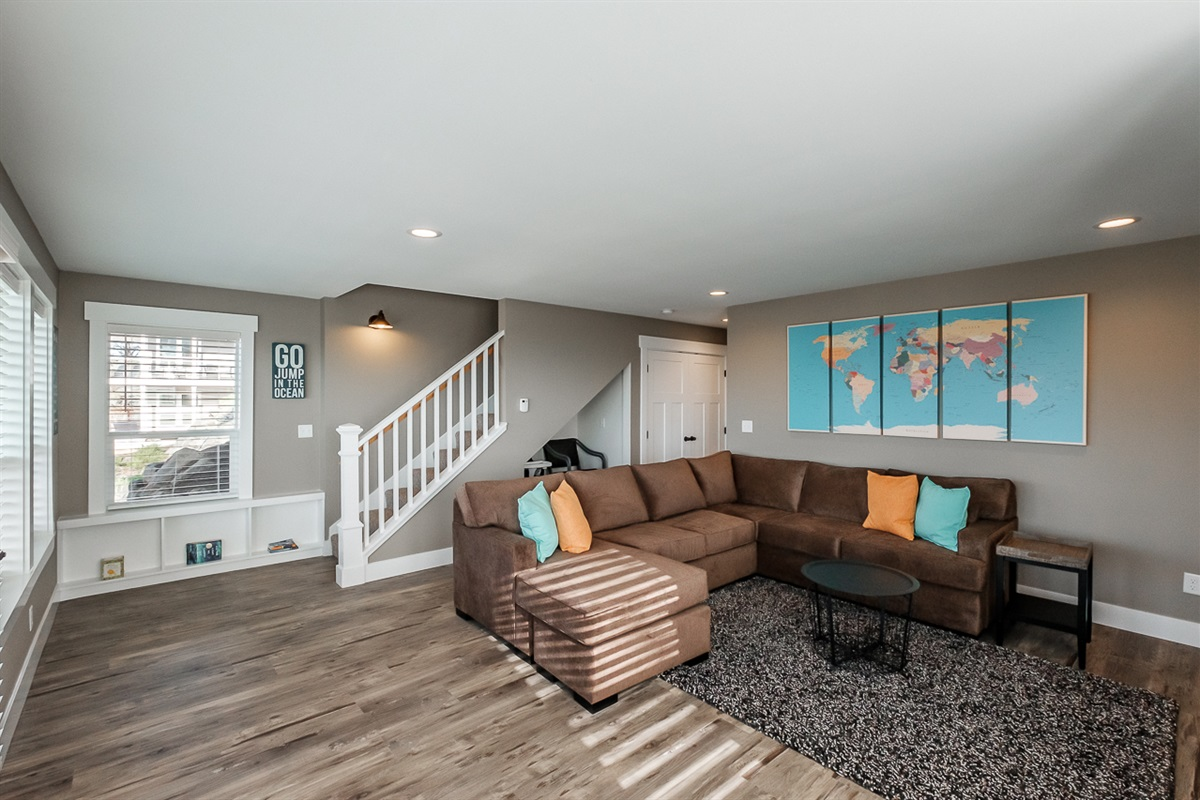 Lower level media serves as a full retreat space for a family or kids.