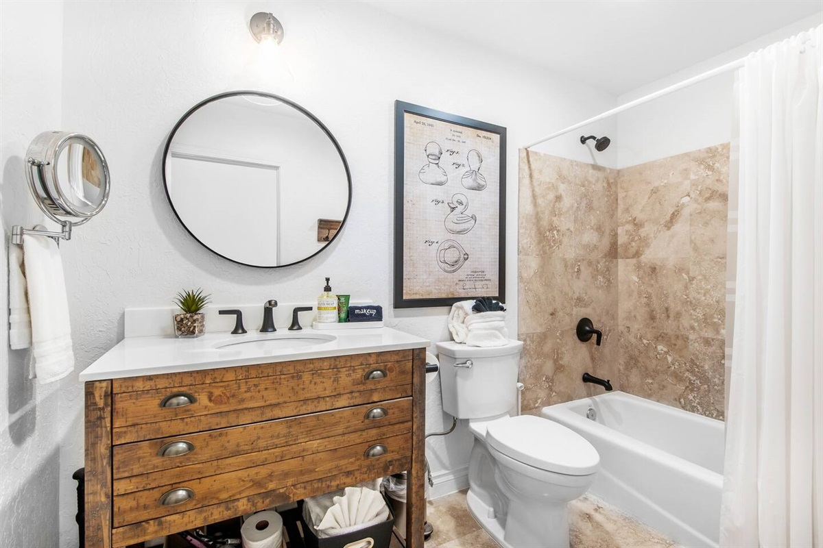 Bathroom #1 (Lower Level): Bathroom with recently remodeled bathtub and shower.