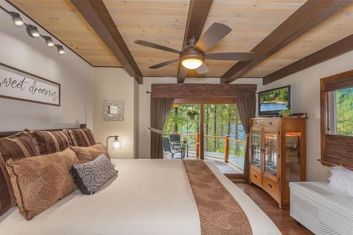 Bedroom #1: It has ceiling fan, 1 queen bed, wood floor, and deck access.