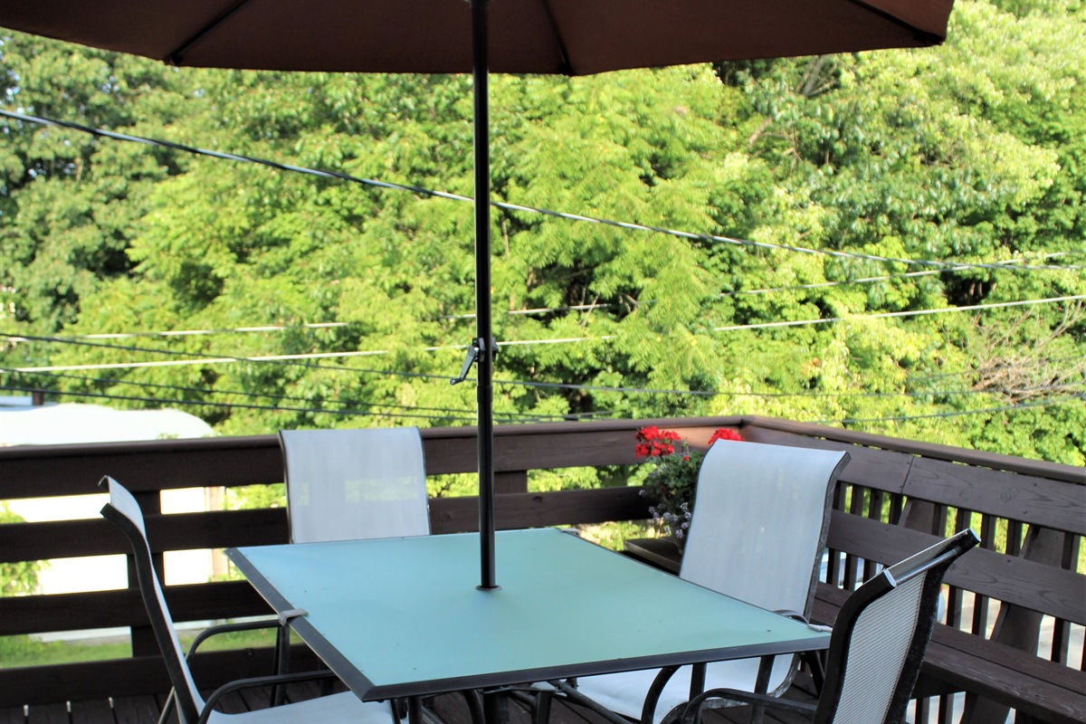 Relax and enjoy the outdoors on your private balcony.  A gas grill on the main patio below is provided for your use