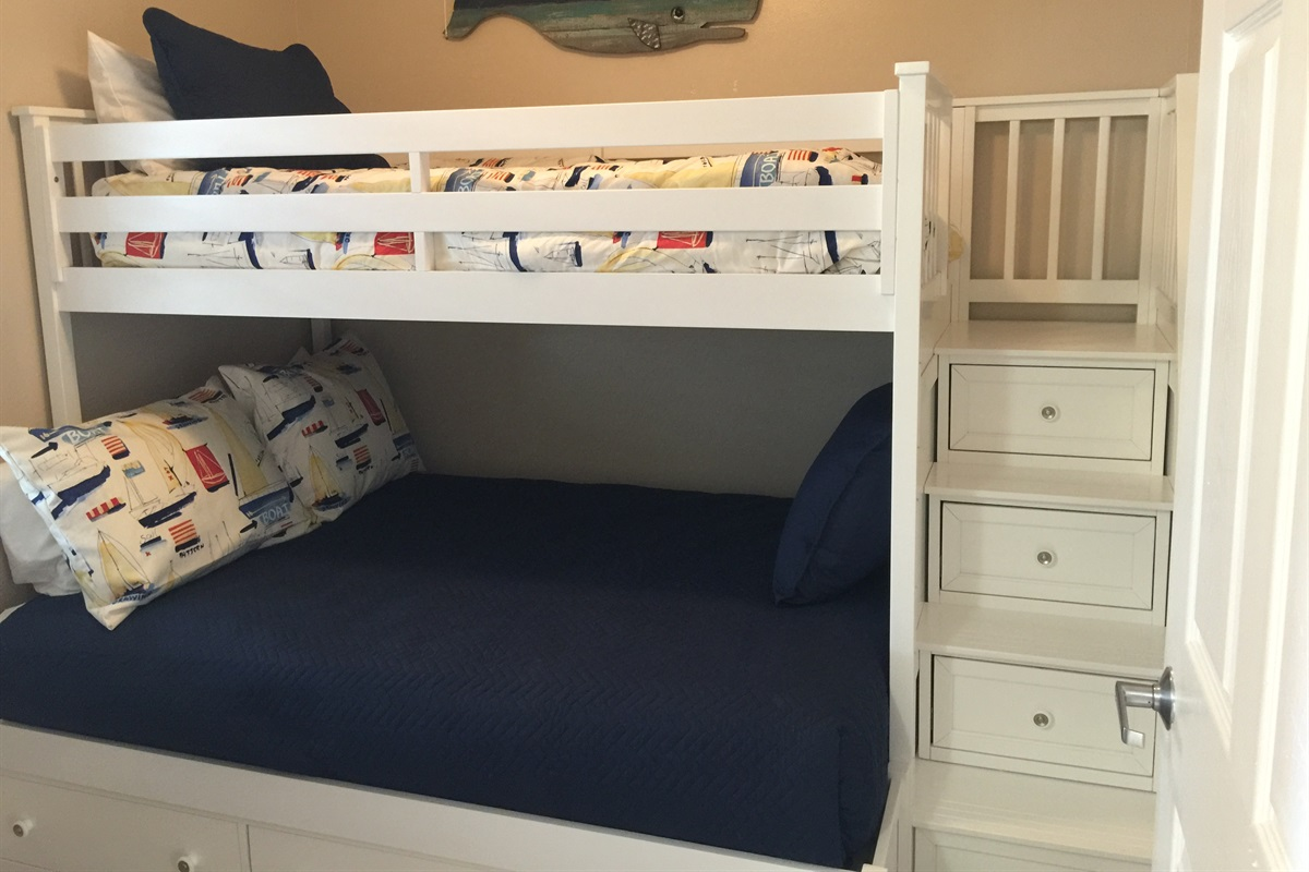 Bunk room does have a door and storage in drawers and chest
