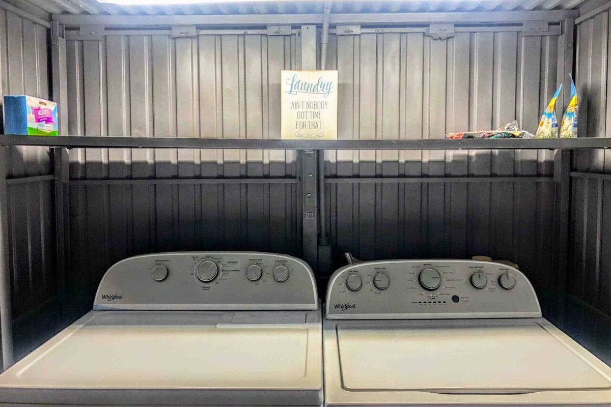 Your laundry facility is located inside the industrial gray shed. The Whirlpool washer is high efficiency with a stainless steel wash basket. The Whirlpool dryer features Wrinkle Shield that will tumble your clothes for up to 90 minutes after drying.