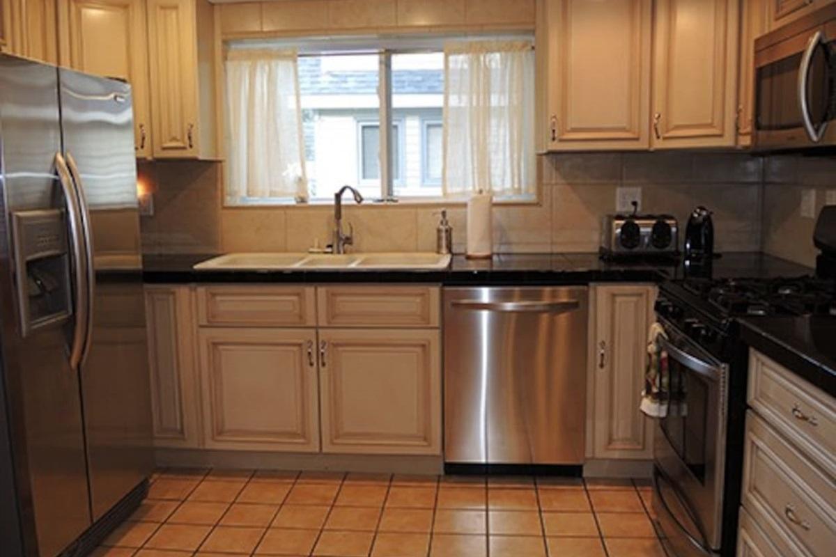 Modern, spacious kitchen with triple basin sink