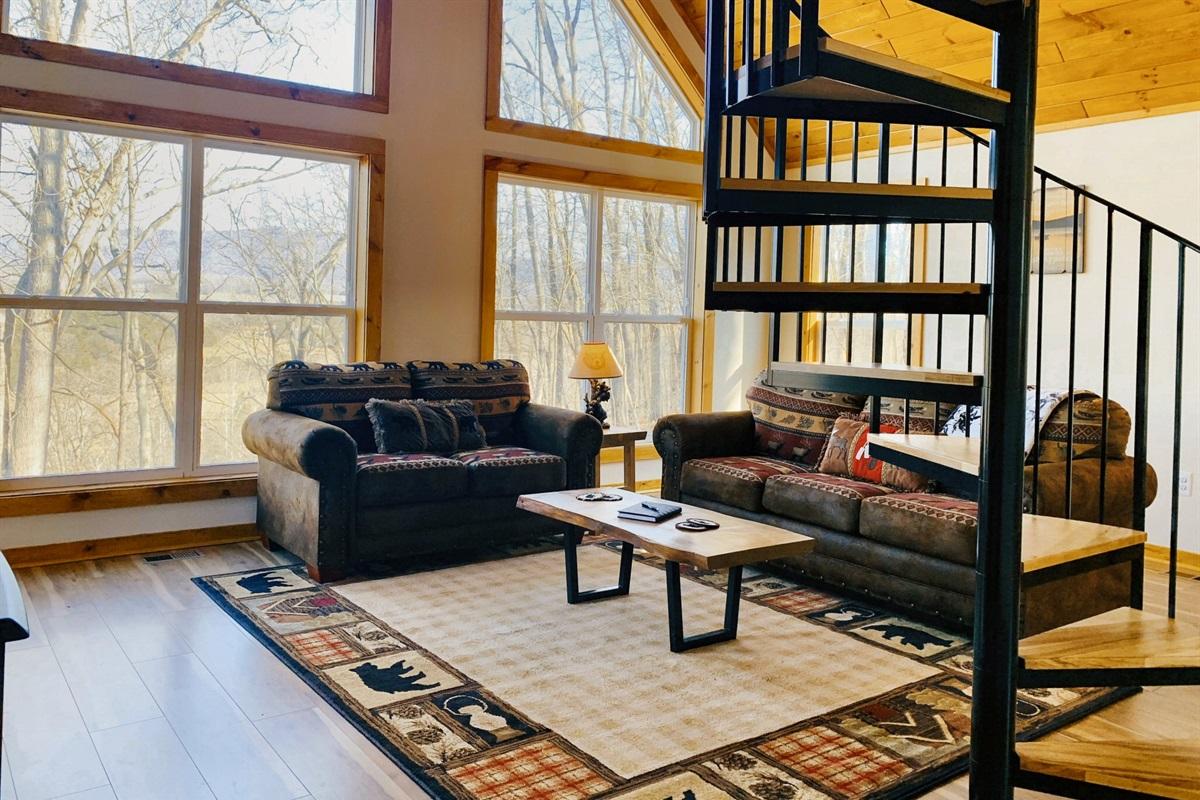 Open living room area with queen-size sleeper sofa