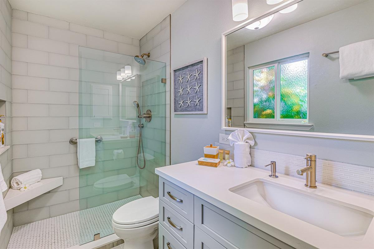 Bathroom #1 - Brand new shower, quartz counters, glass tile, corner bench