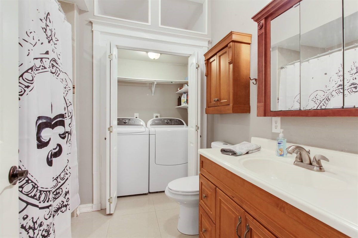 Downstairs hallway bath. Shared for bedrooms 2 & 3. Full laundry.