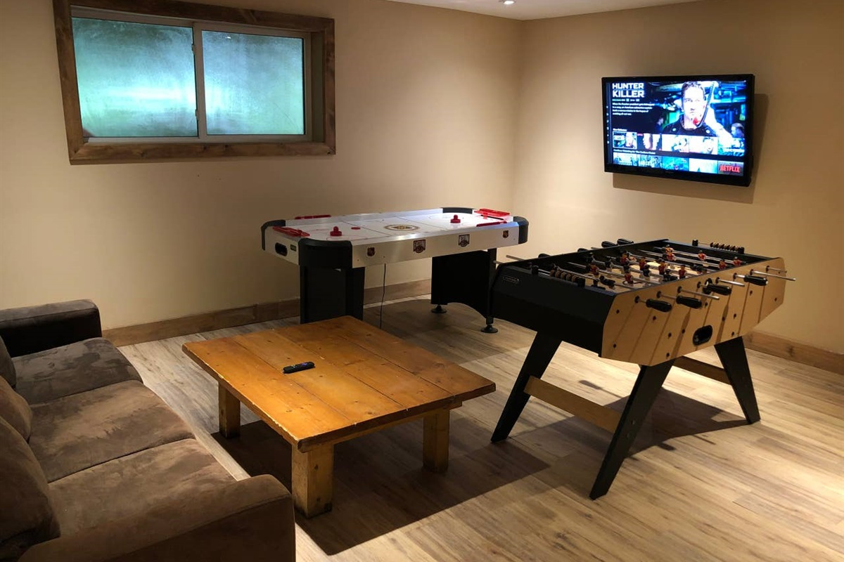 "Lower level game room with Air Hockey, Foosball Table and 50"" HDTV connected with Netflix & Amazon Prime Video"