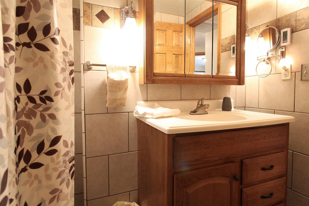 Fully tiled bath with heated floor