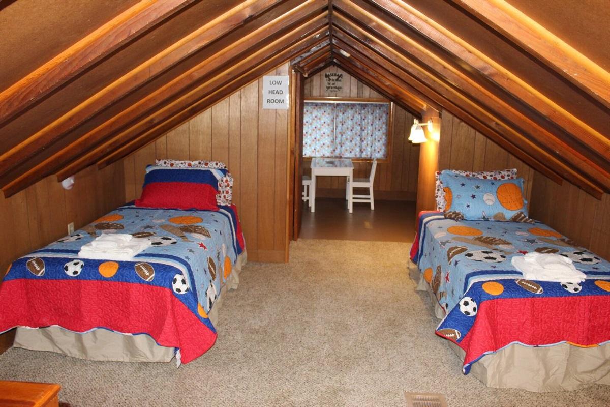 Upper level twin bedroom with bonus rec area