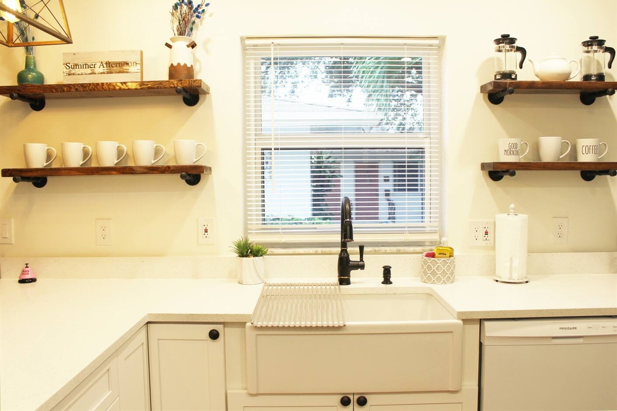 Featuring our porcelain white farm sink with bronze faucet.