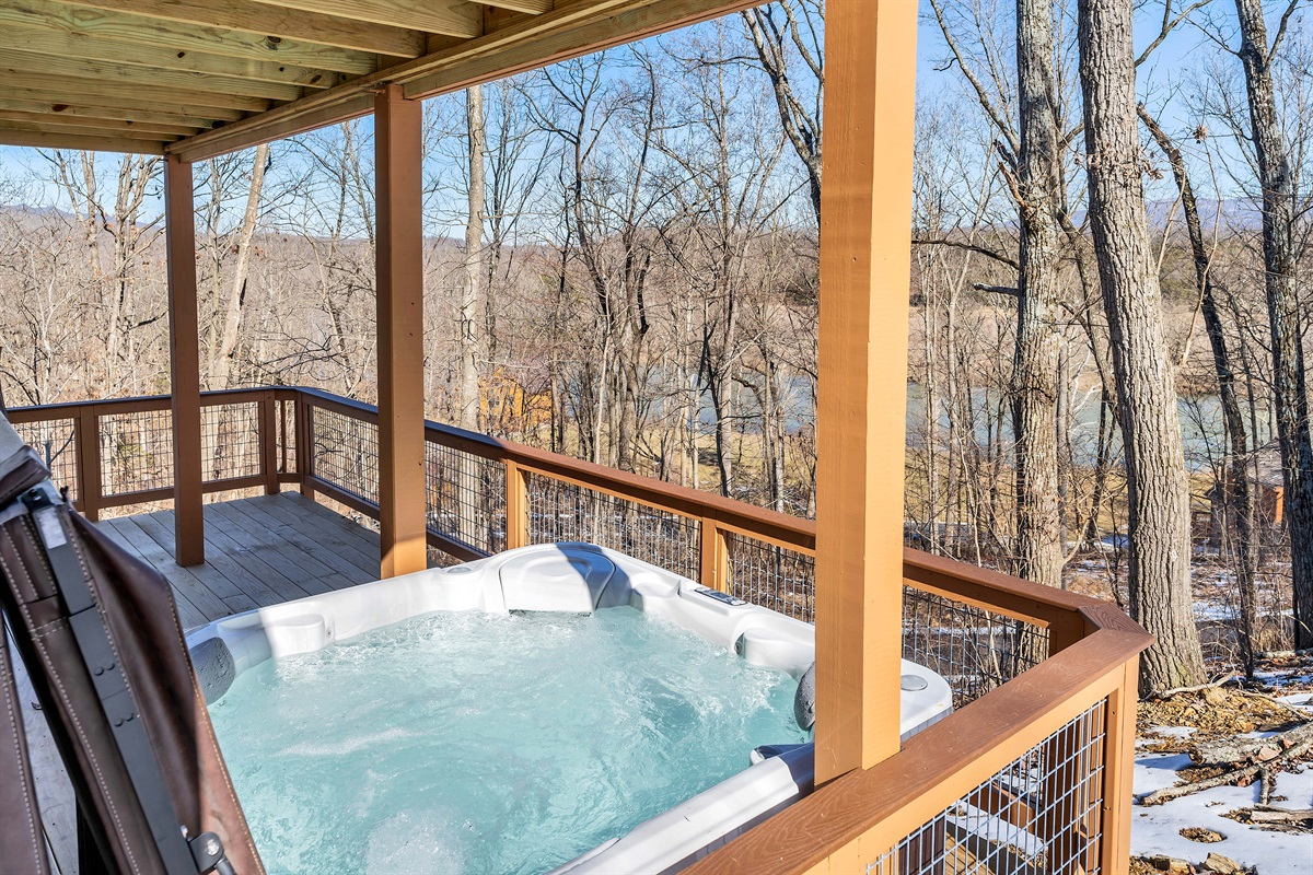 Enjoy the hot tub and a view of the woods