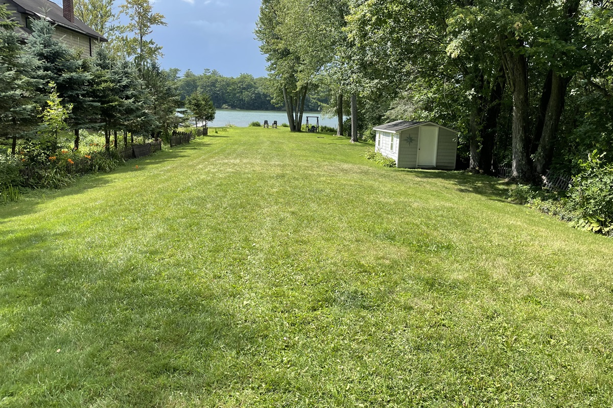 Large lawn leading to the waterfront